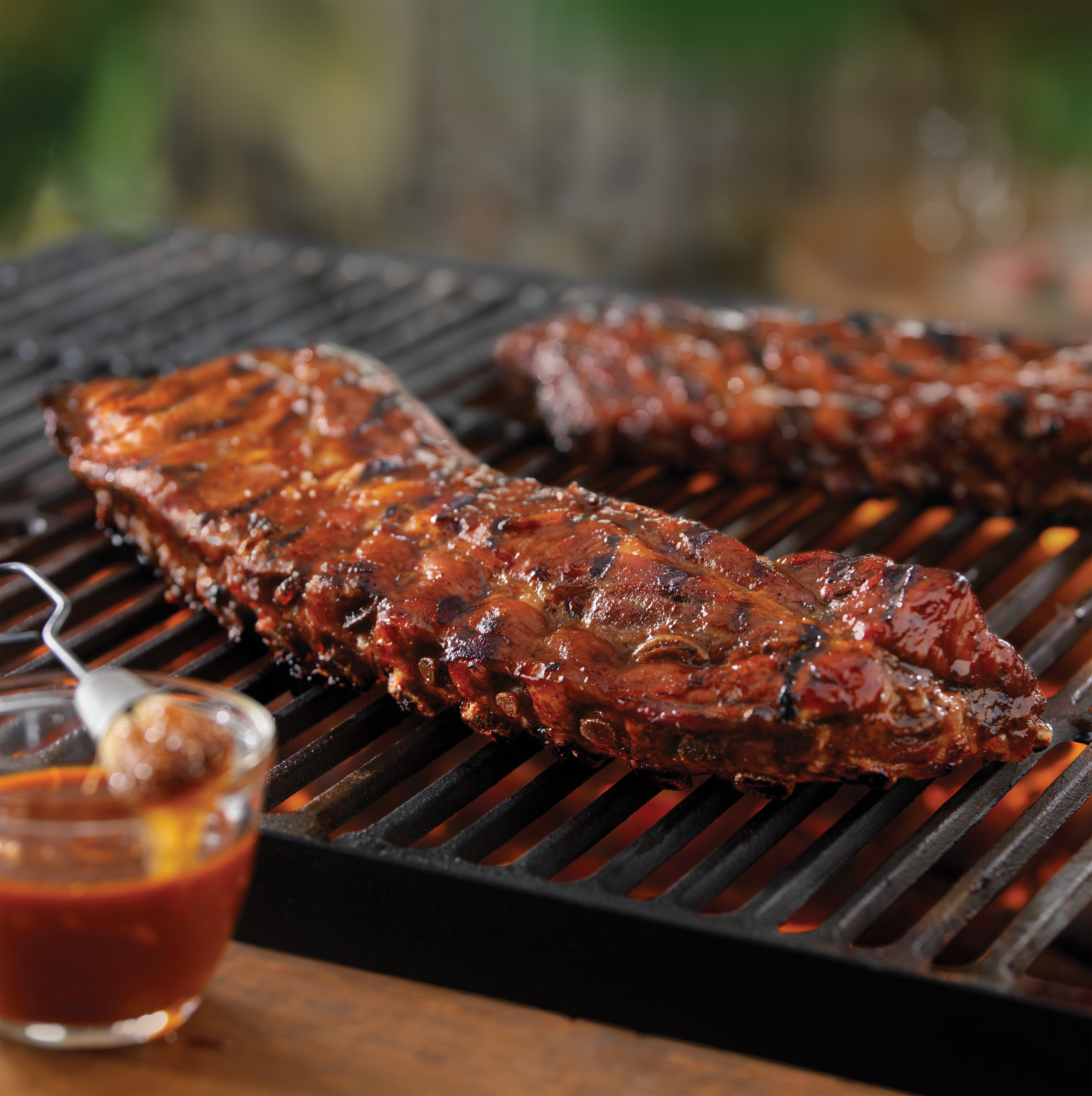 Tangy grilled back ribs pork recipes pork be inspired - Ribs on the grill recipe ...