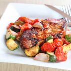 Grilled Pork Chops with Tomato and Zucchini